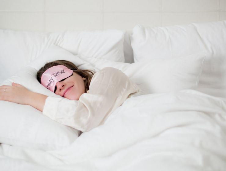 Lady fast asleep in bed with pink sleeping mask on