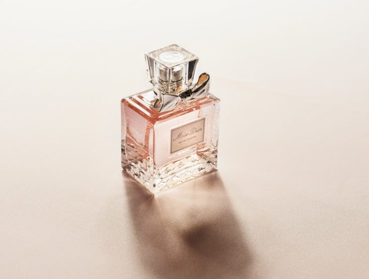 Pink Miss Dior Perfume bottle on a pink background