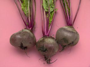 three beetroot to treat dark lips on pink background