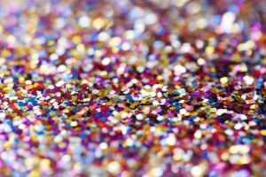 Colorful glitter makeup particles scattered all over