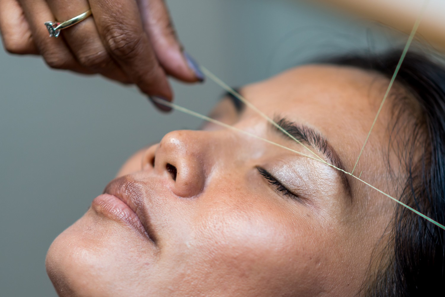 close up picture of a woman having her eyebrows threaded, which is not recommended for sensitive skin.