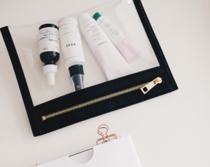 A clear makeup bag full of beauty products