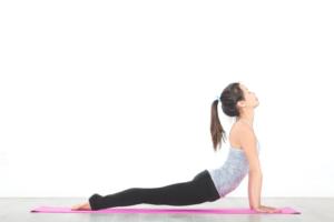 Woman doing a stretch yoga pose on a yoga mat