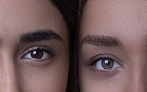 two women with just half their face visible