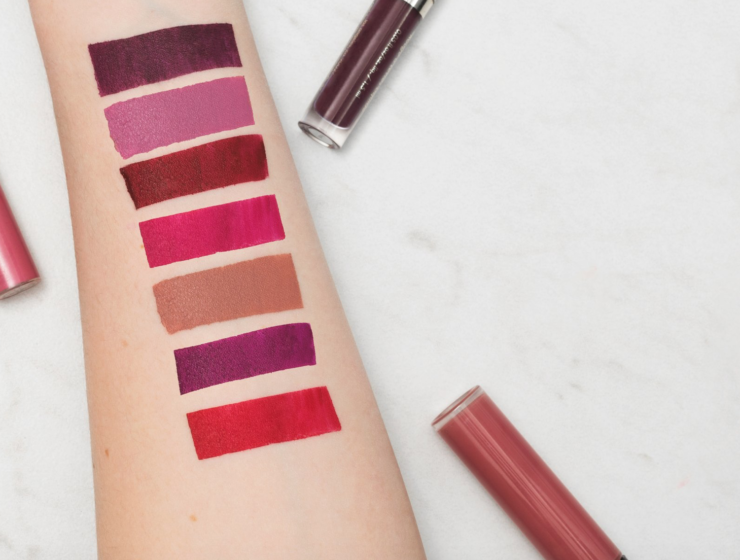 Woman's arm with lipstick swatches on it