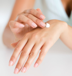 Woman applying lotion to her hand