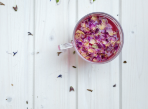 Herbal tea in a cup with flower petals inside
