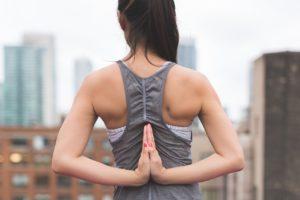Woman doing a yoga pose on a balcony