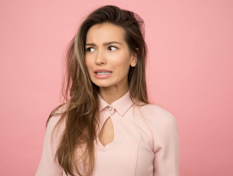 Woman wearing pink and making a facial expression