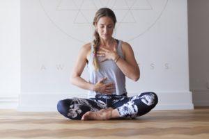 Woman doing yoga and meditating