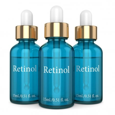 three blue bottles with droppers, each titled Retinol on the front.