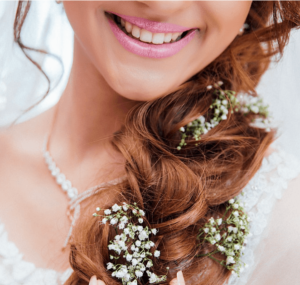 A bride wearing a wedding dress and flowers in her hair