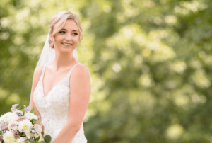 A bride in a wedding dress holding a bouquet