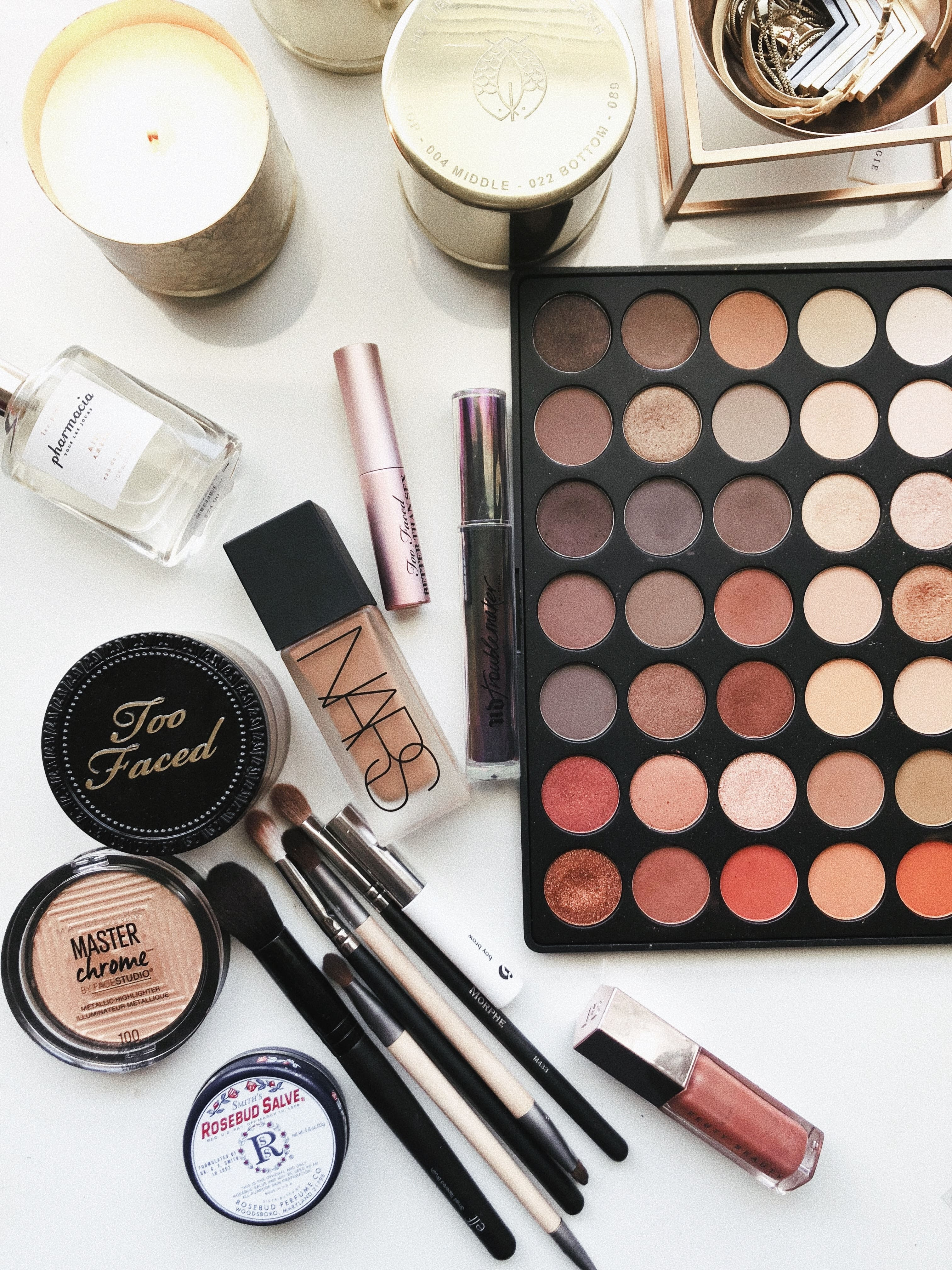an array of makeup, foundation, lipsticks and eyeshadows.