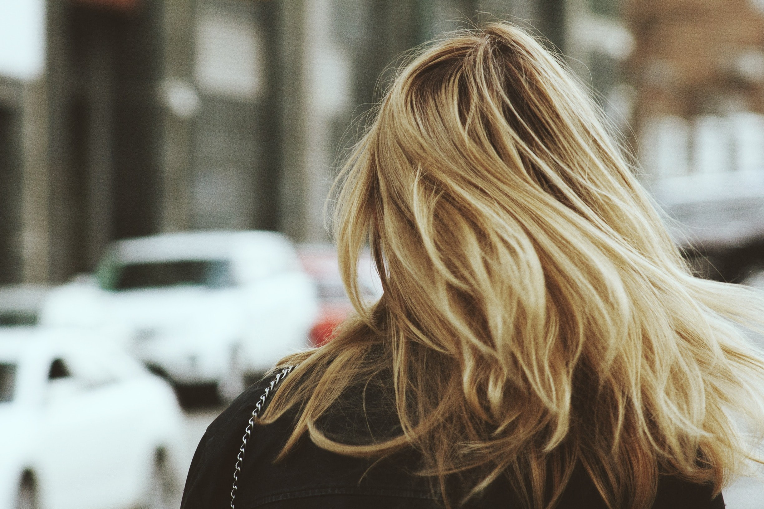 hair myths: woman with blonde hair, pictured walking from behind.