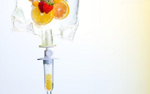 IV Full of liquid and sliced fruit.