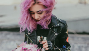 Woman with colourful hair wearing a leather jacket