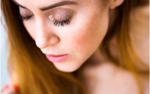 Woman wearing false eyelash extensions