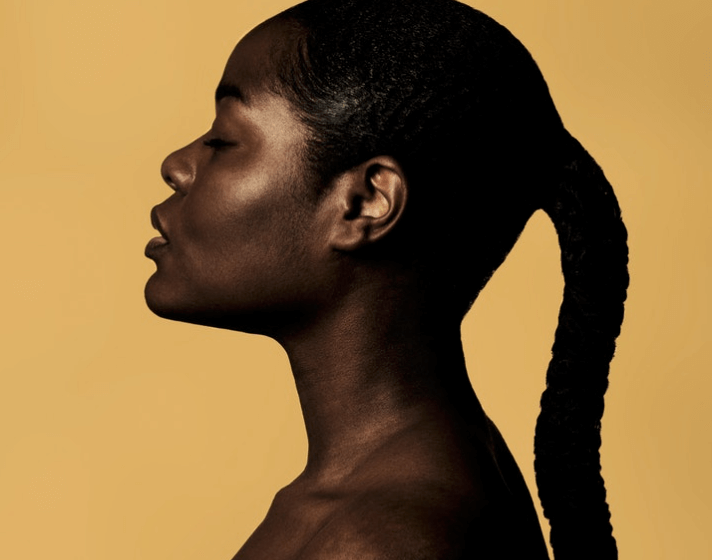 A woman with dewy, glowing skin