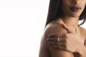 A woman touching her shoulder