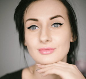 Woman wearing winged eyeliner on her eyelids