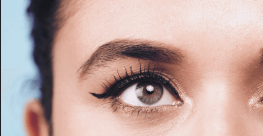 Woman with winged eyeliner on her eyes