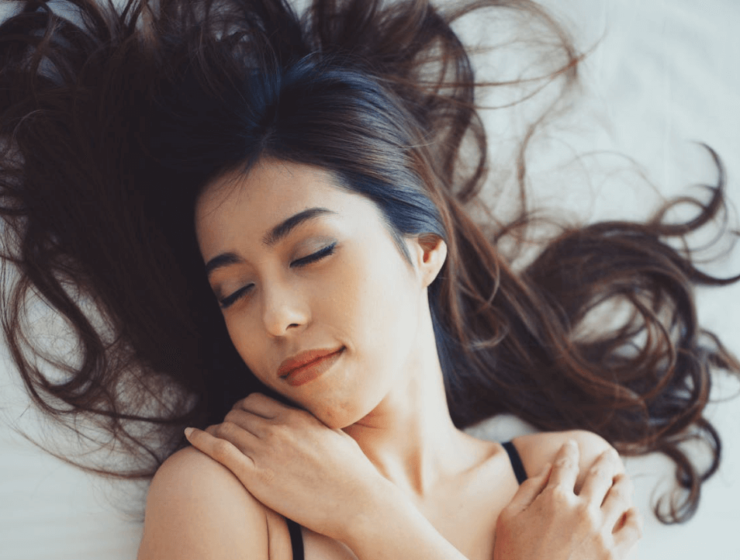 Woman with long hair sleeping
