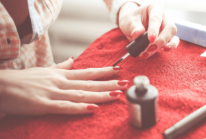 Woman applying nail polish to her nails