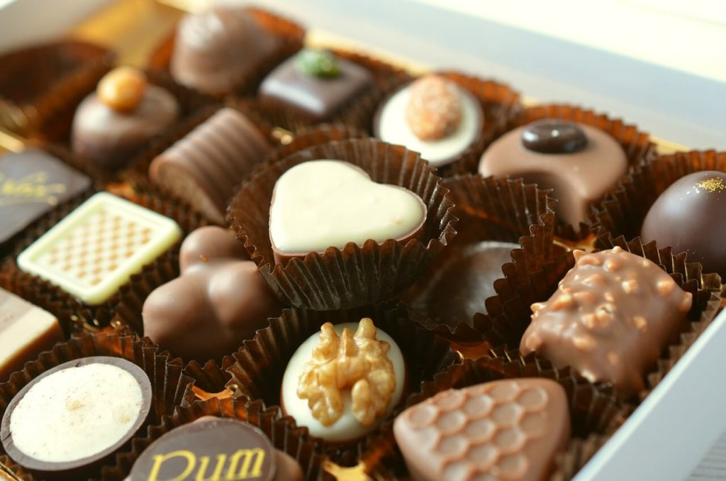 A selection of chocolates in a chocolate tray