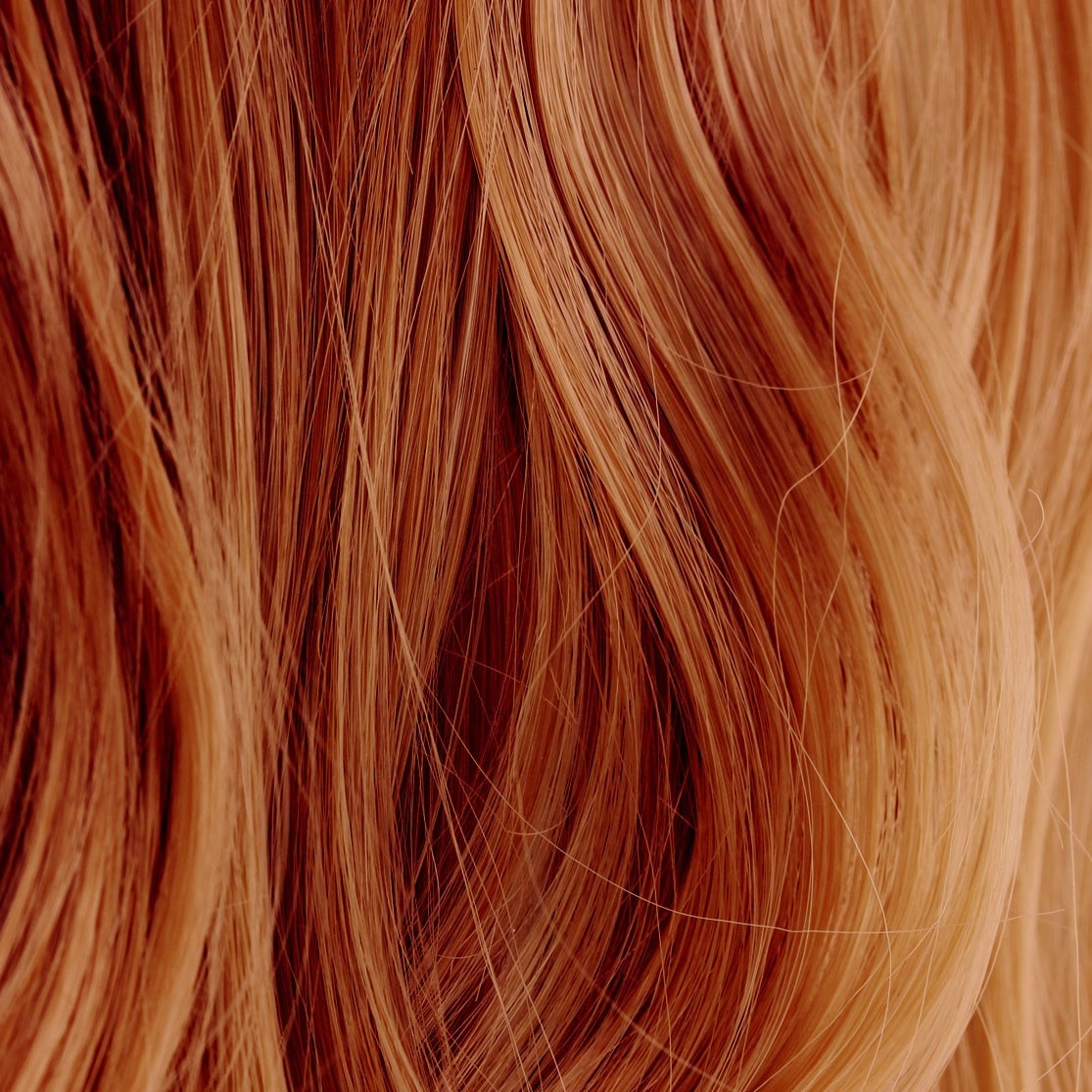 henna dyed hair strands, close up.