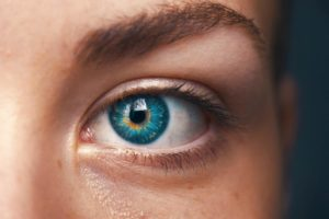 A close up image of a woman's blue eyes