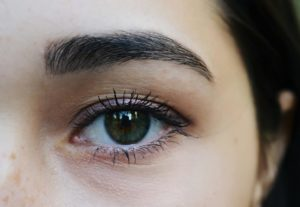 Woman with thick, full eyebrows