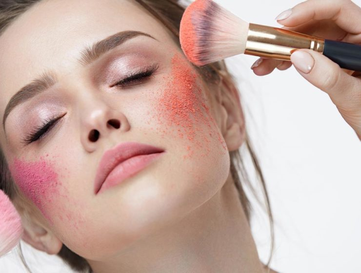 pink orange powder displayed on models cheeks.