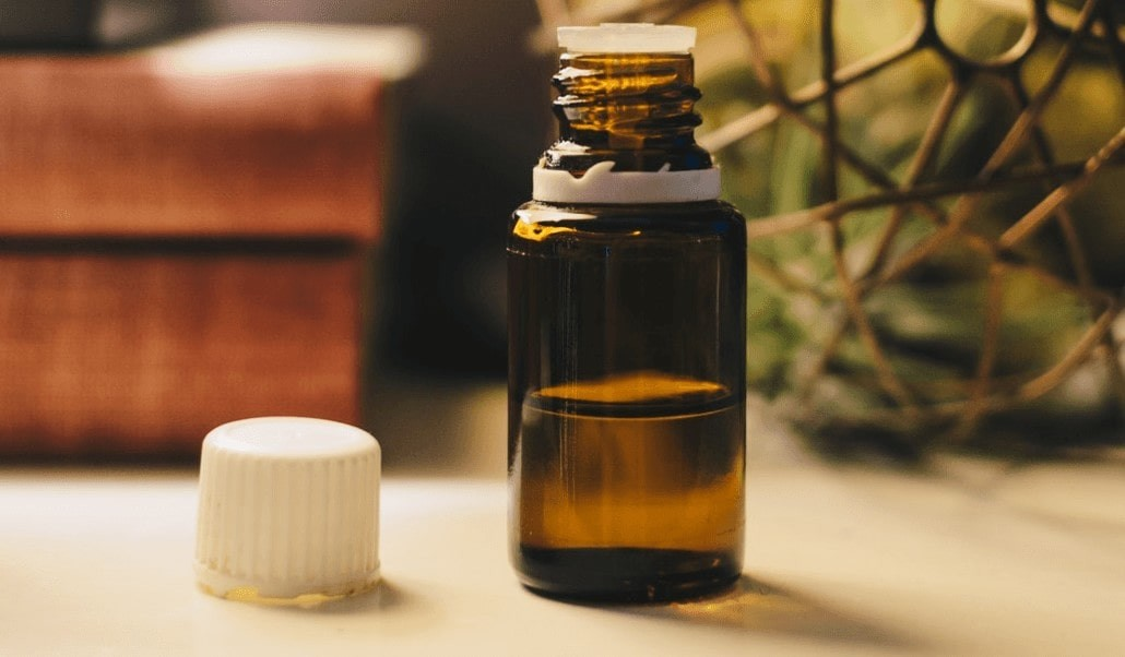 A small bottle of tea tree oil with a medicinal lid.