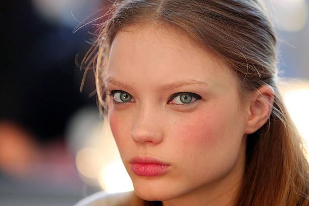 woman with pale skin wearing blush.