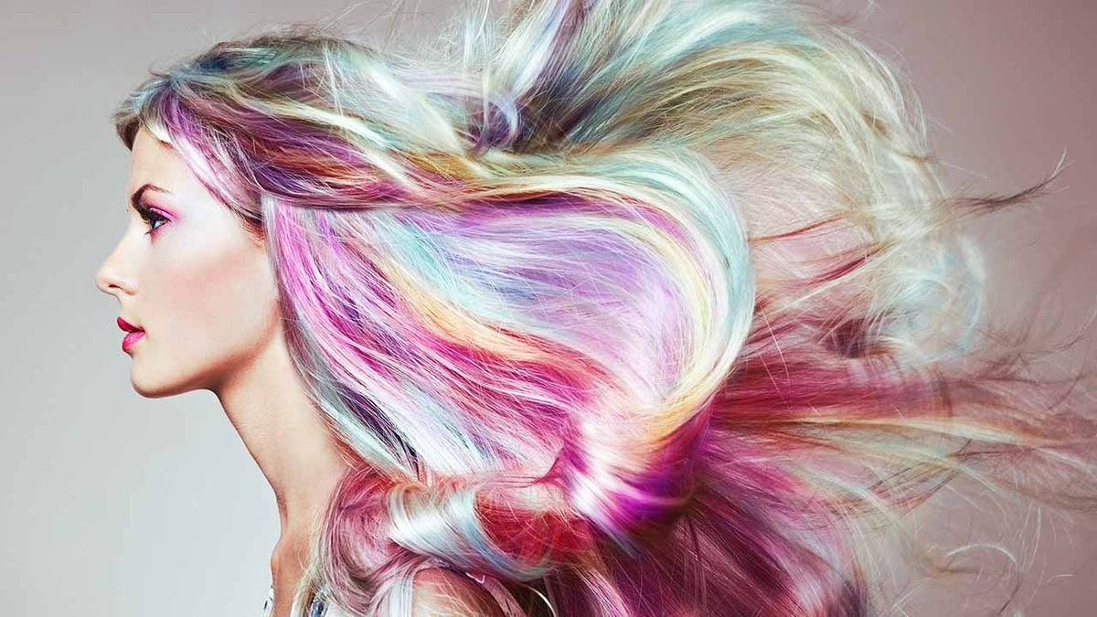 woman with unicorn colourful hair, profile pictured.