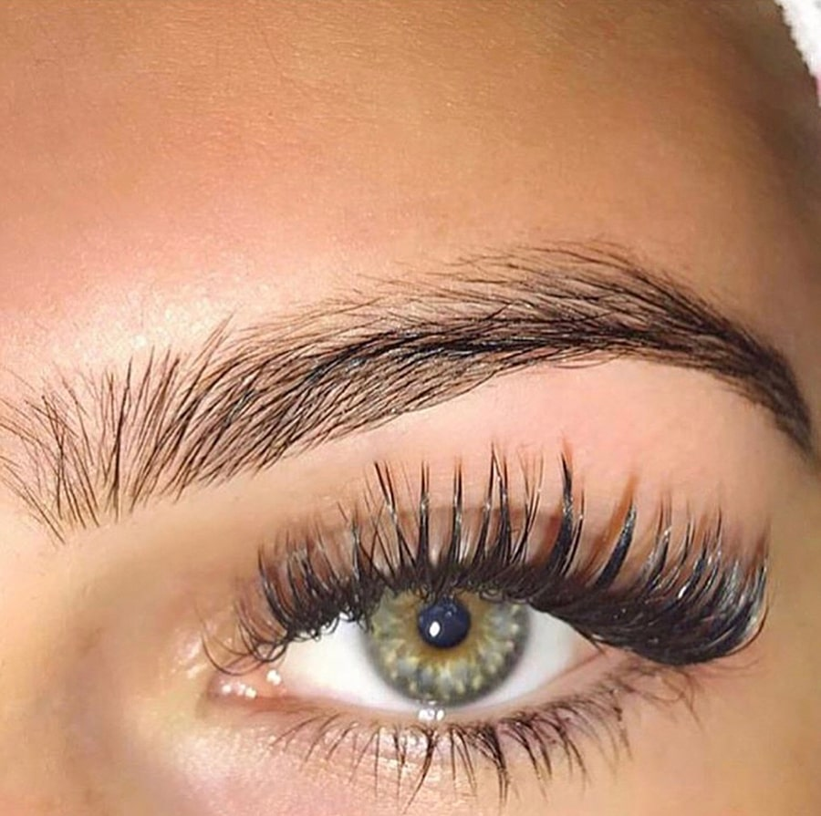 close up of womans eye with lash extension.