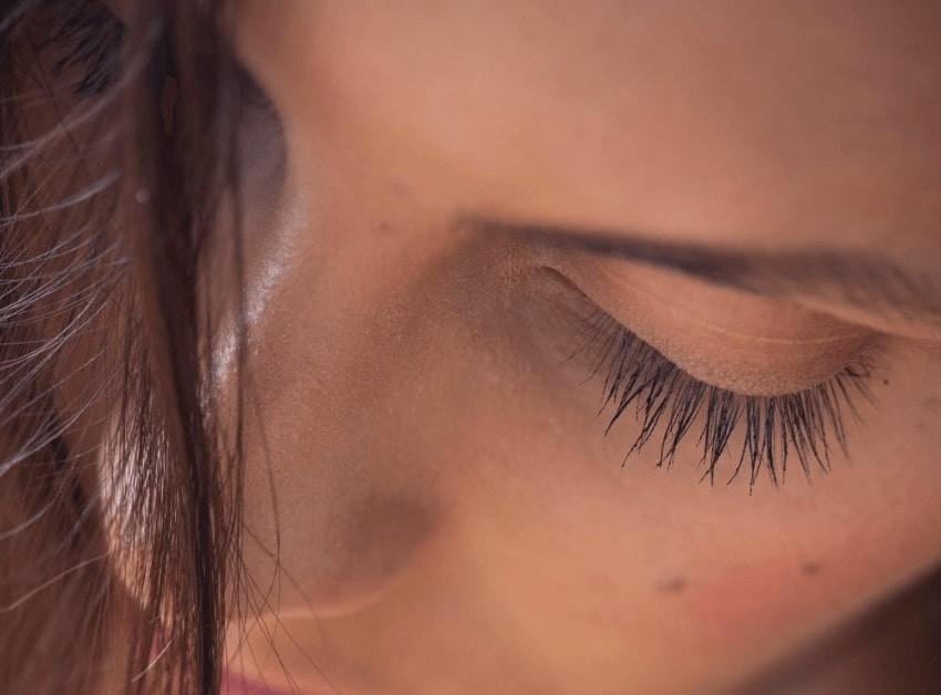Woman wearing false eyelash extensions.