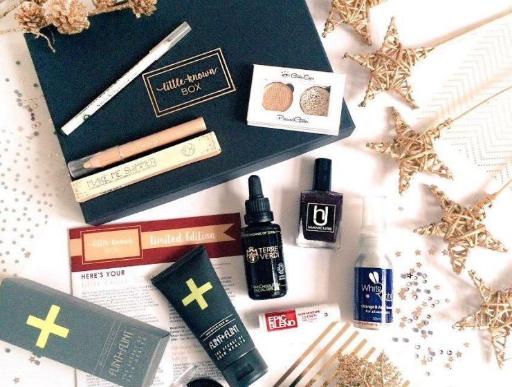 Brand 'LittleKnown' box with various cosmetic products and wooden ornaments.