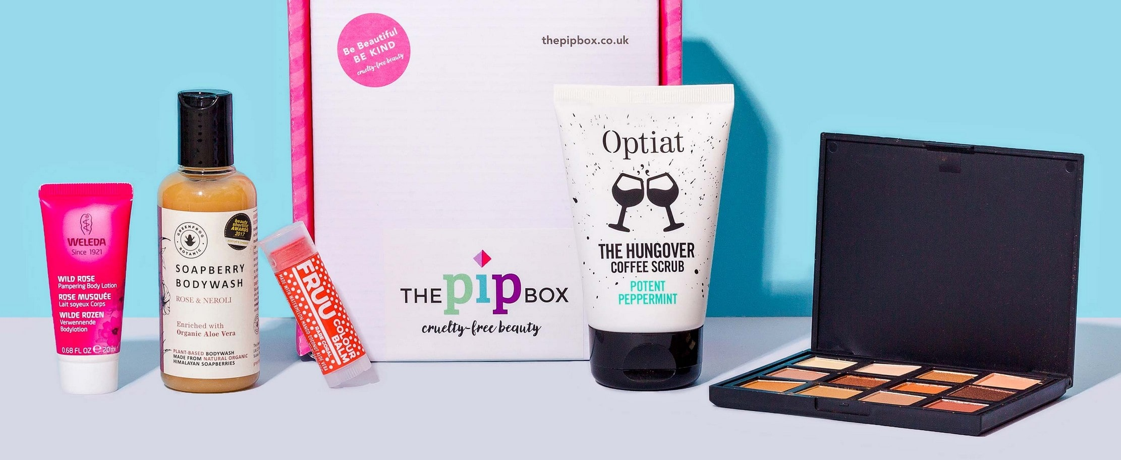 Beauty subscription boxes: The Pip Box with cosmetic products on a blue background.
