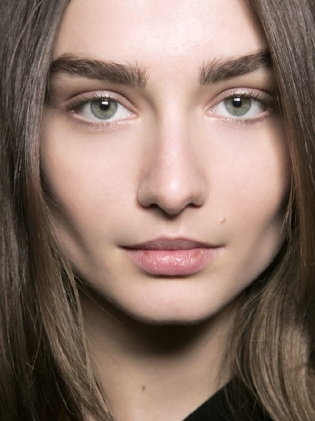 woman with strong defined eyebrows and cheekbones.