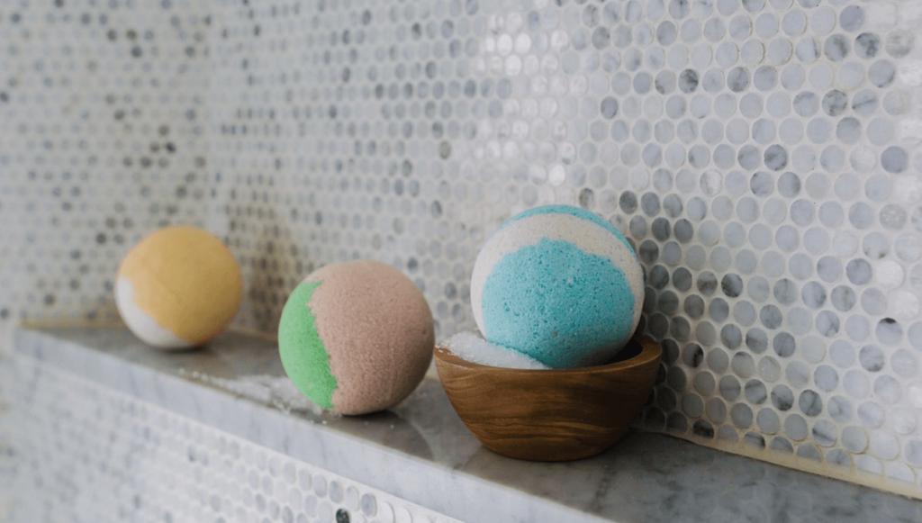 Three bath bombs in a bathroom