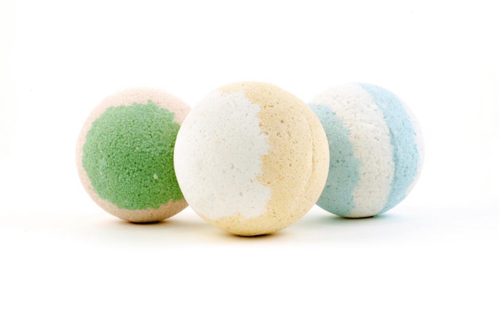 Three different coloured bath bombs