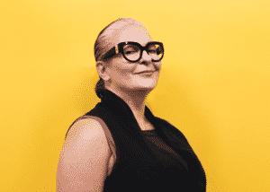 a mature woman wearing glasses