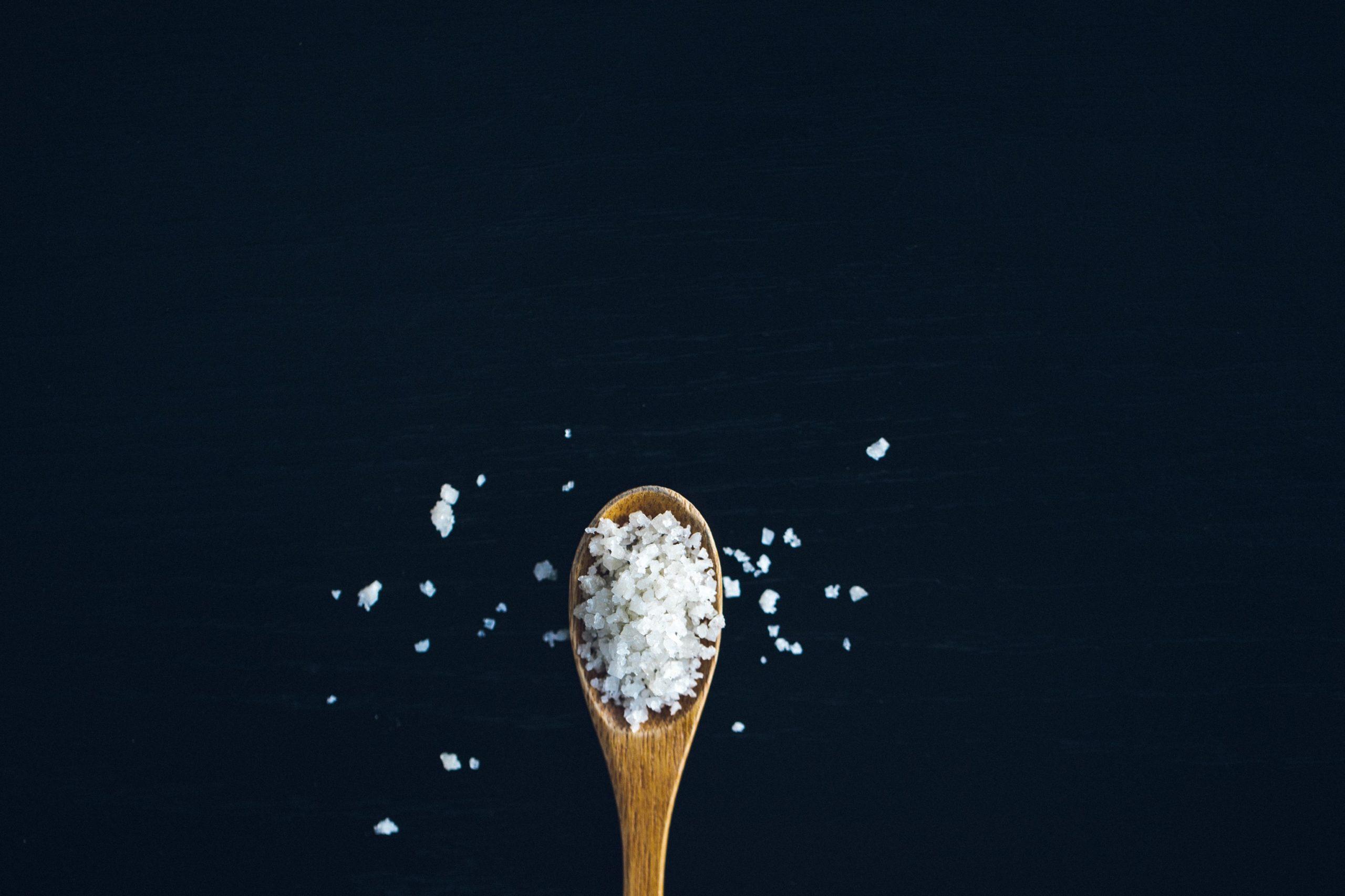 sea salt upon a wooden spatula.