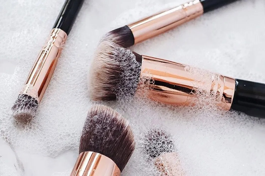 makeup brushes in soap bubbles.