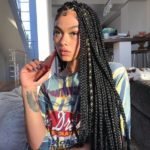 a woman pictured with coloured box braids.